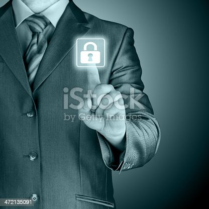 896596886 istock photo Businessman in suit pressing a lock security button graphic 472135091