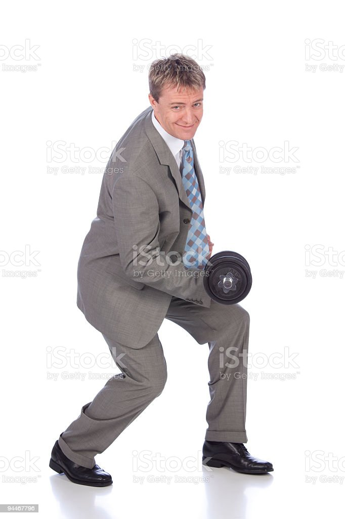 businessman in suit  training with dumbbell royalty-free stock photo