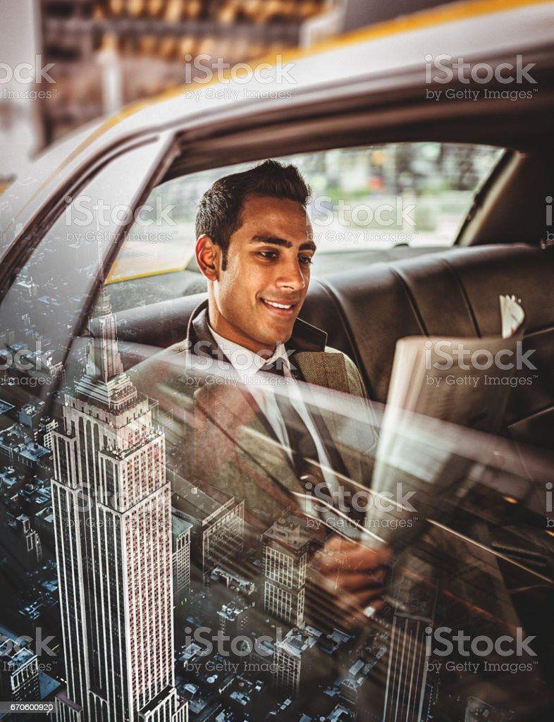 businessman in taxi in nyc stock photo