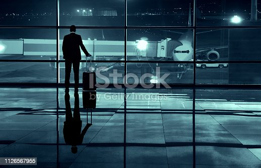 509630674 istock photo Businessman in the airport 1126567955