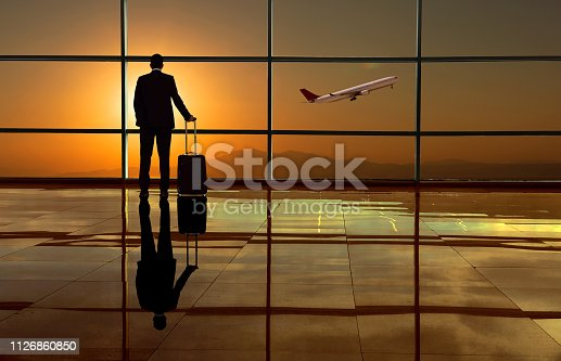 509630674 istock photo Businessman in the airport 1126860850