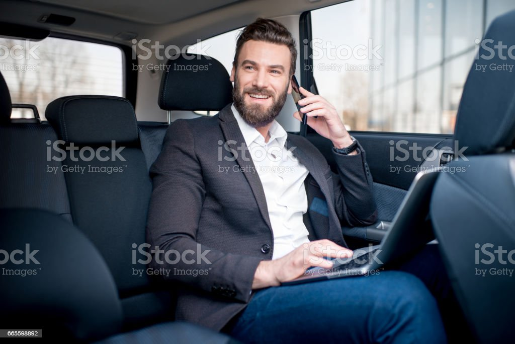 Businessman in the car stock photo