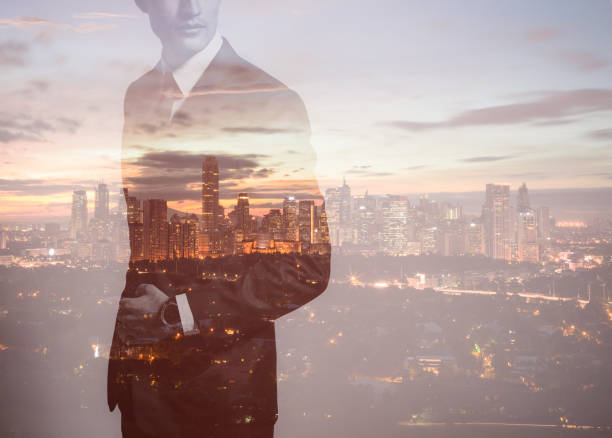 Businessman in the city, double exposure stock photo
