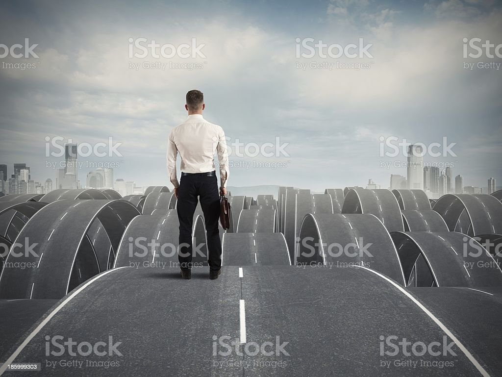 Businessman in the face of difficulties stock photo