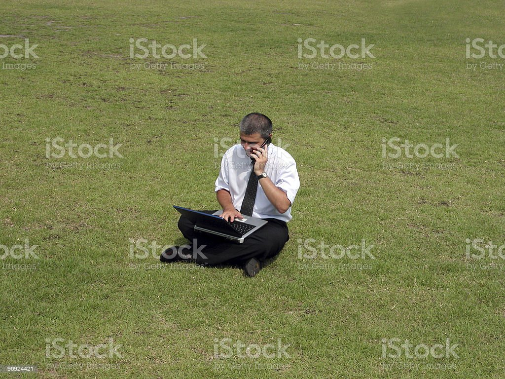 Businessman in the field royalty-free stock photo