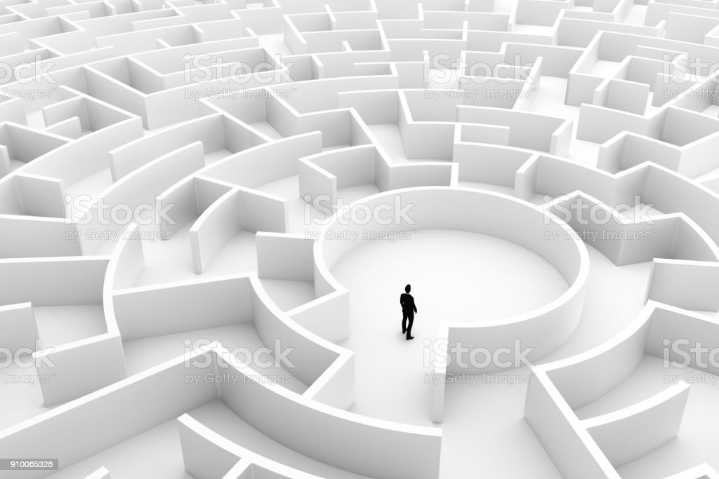 Businessman in the middle of the maze. Challenge concepts stock photo