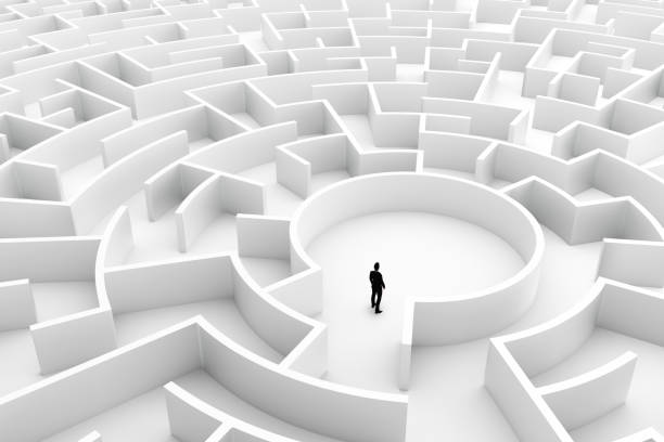 businessman in the middle of the maze. challenge concepts - maze stock photos and pictures