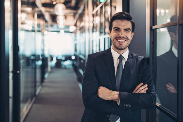 Businessman in the office building corridor stock photo