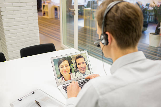 businessman in the office on videoconference with headset, skype - video call bildbanksfoton och bilder