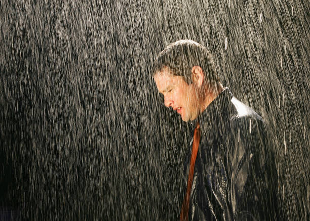 businessman in the rain - drenched stock pictures, royalty-free photos & images