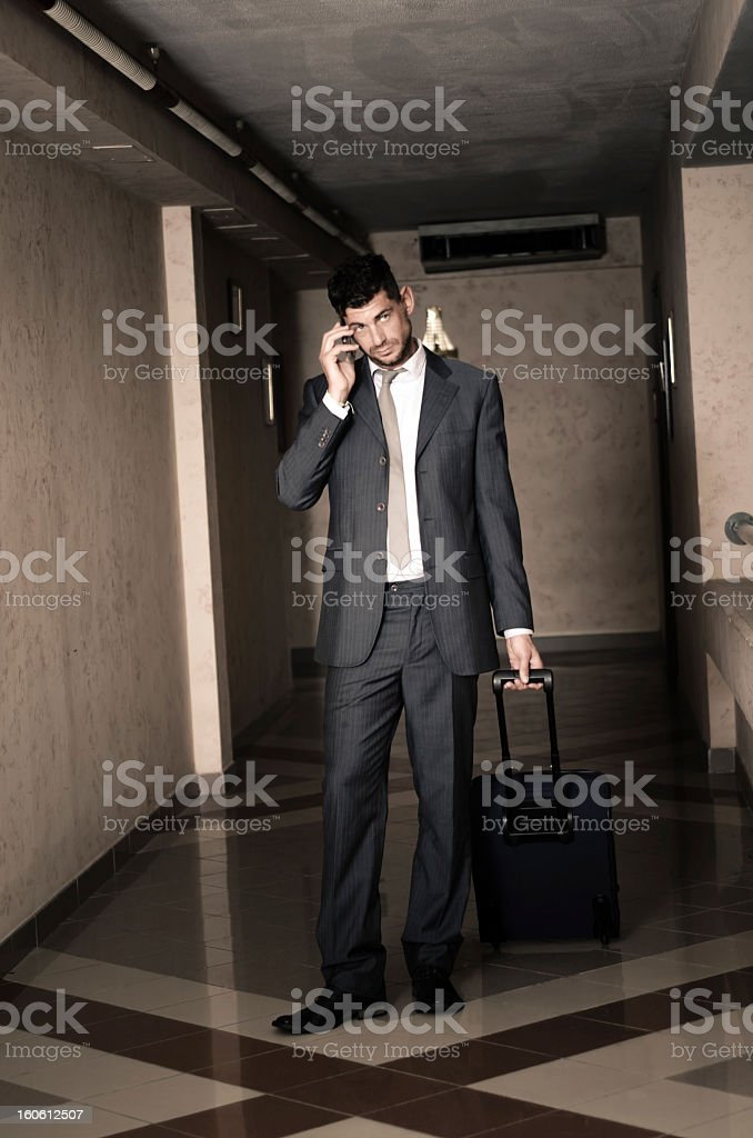 Businessman in travel calling with mobile phone royalty-free stock photo