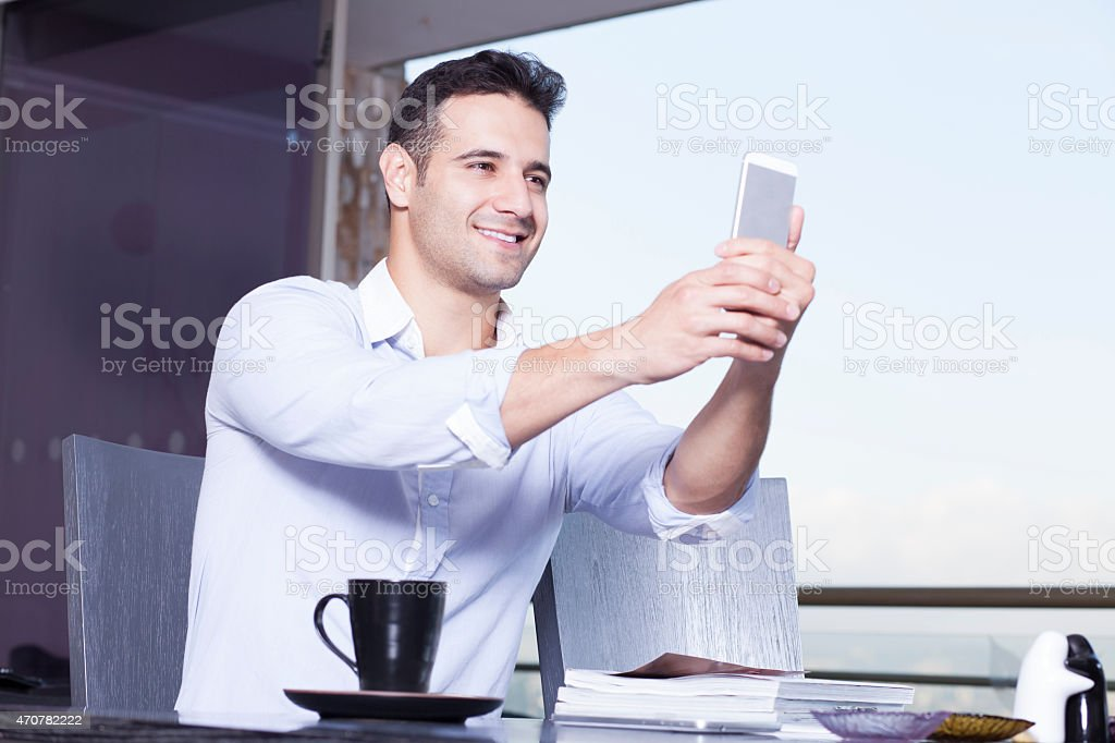 Businessman In Video Call With His Cellphone stock photo