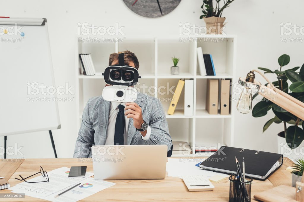 businessman in vr headset stock photo