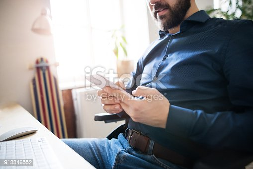 913346608 istock photo Businessman in wheelchair at the desk in his office. 913346552
