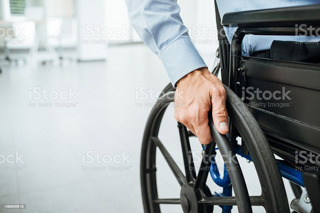 Businessman in wheelchair stock photo