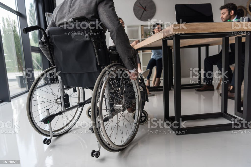 businessman in wheelchair stock photo