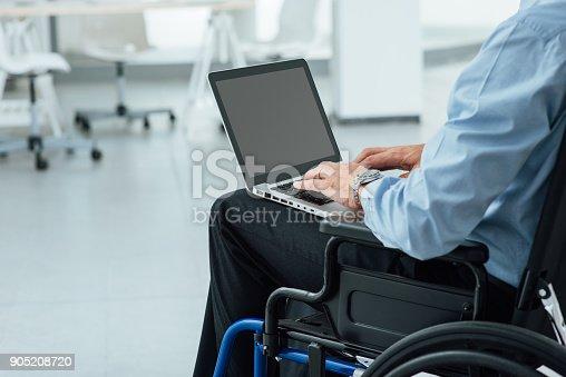 1144373653 istock photo Businessman in wheelchair 905208720
