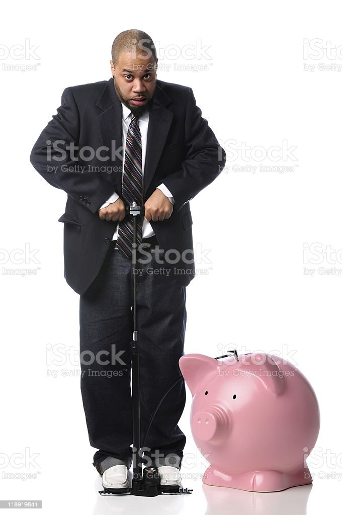 Businessman Inflating Piggy Bank royalty-free stock photo