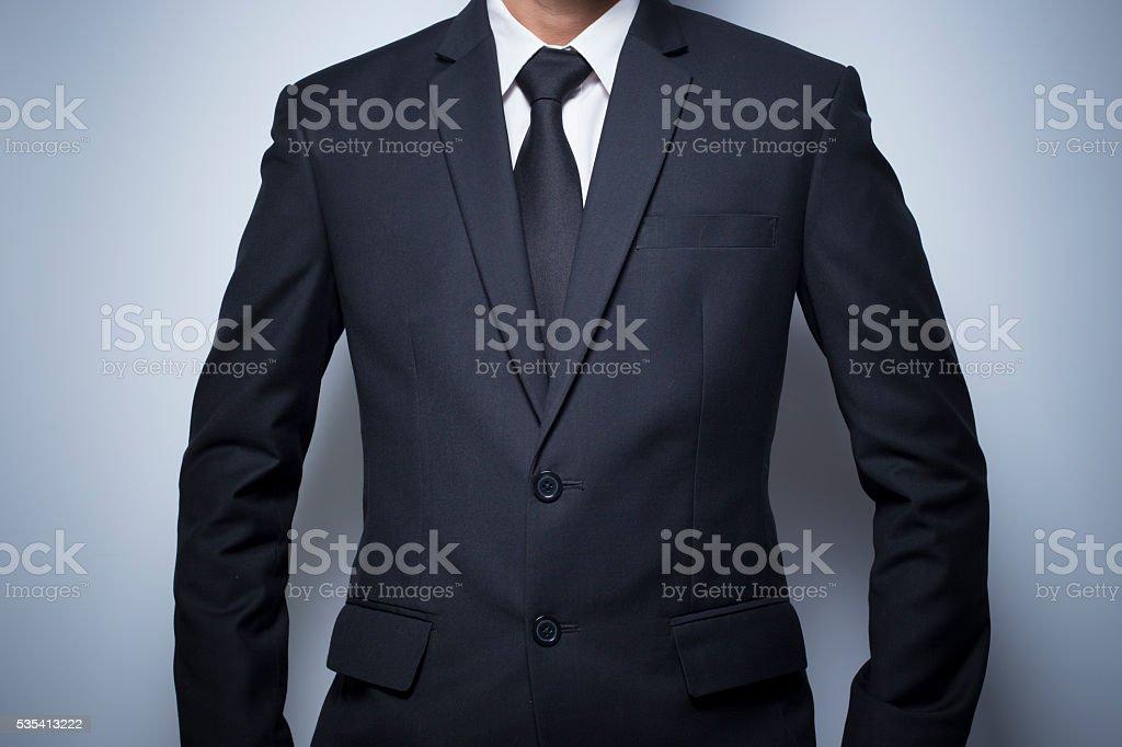 Businessman informal akimbo action stock photo