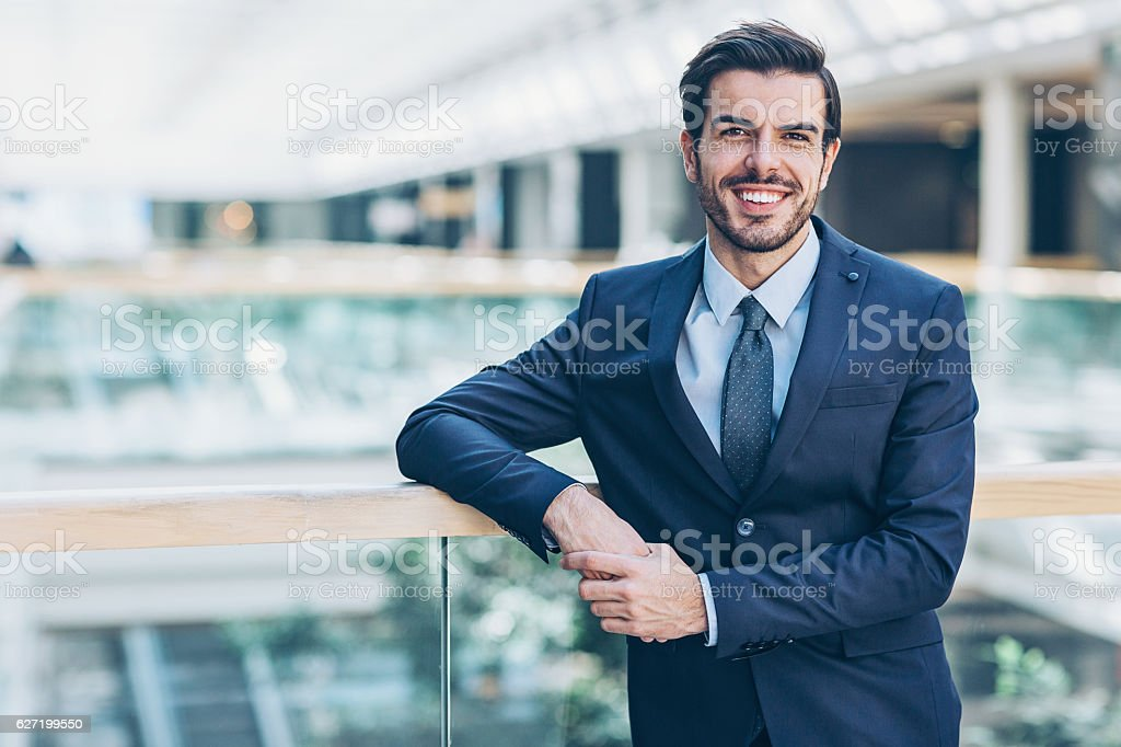 Businessman inside modern office building stock photo