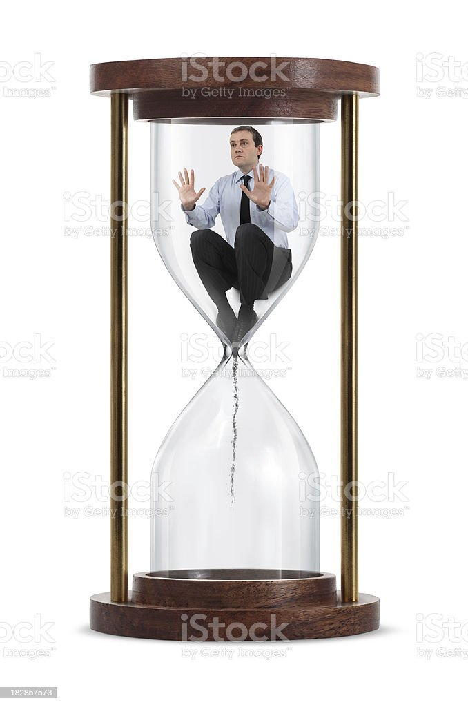 Businessman Inside The Hourglass stock photo