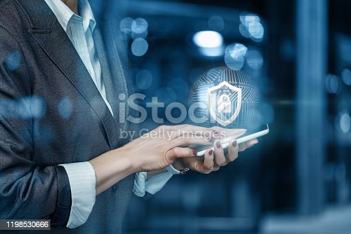 1156072209istockphoto A businessman installs protection to the mobile device . 1198530666