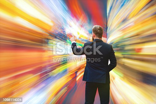 istock Businessman interacting in VR 1098114024