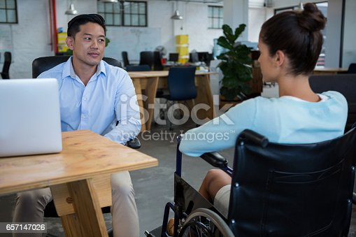 660681964istockphoto Businessman interacting with disabled colleague 657147026