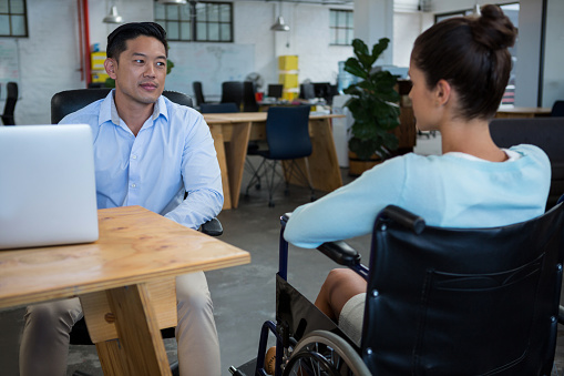660681964 istock photo Businessman interacting with disabled colleague 657147026