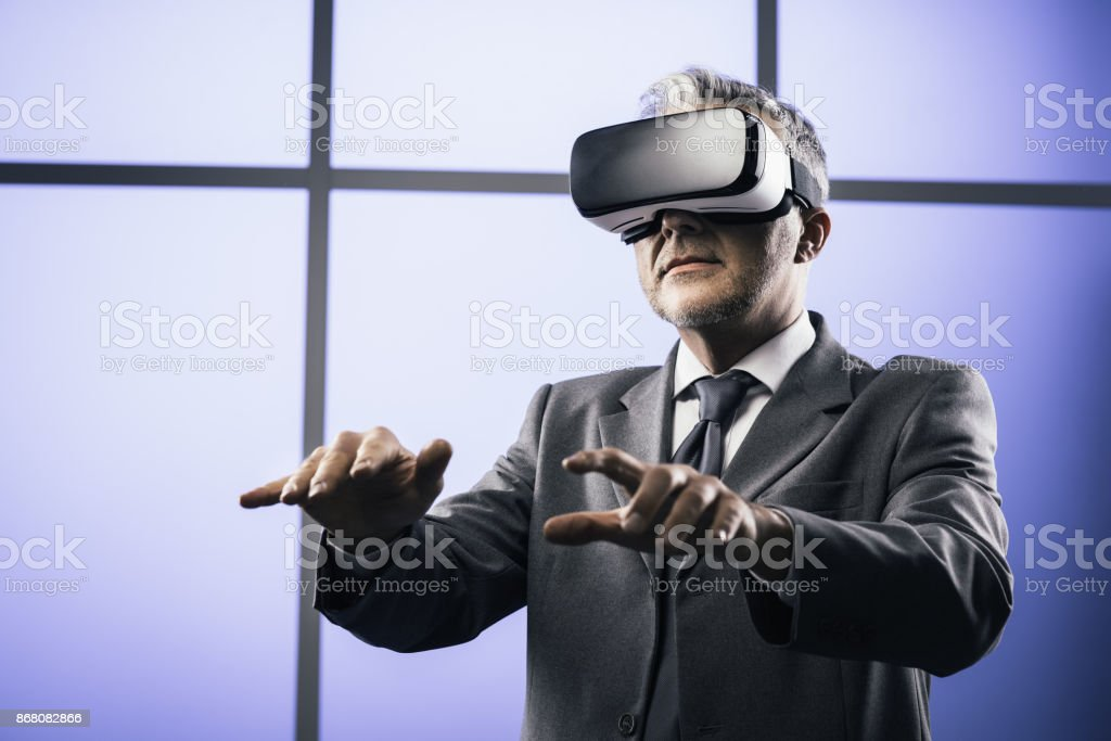 Businessman interacting with virtual reality - Royalty-free 360-Degree View Stock Photo