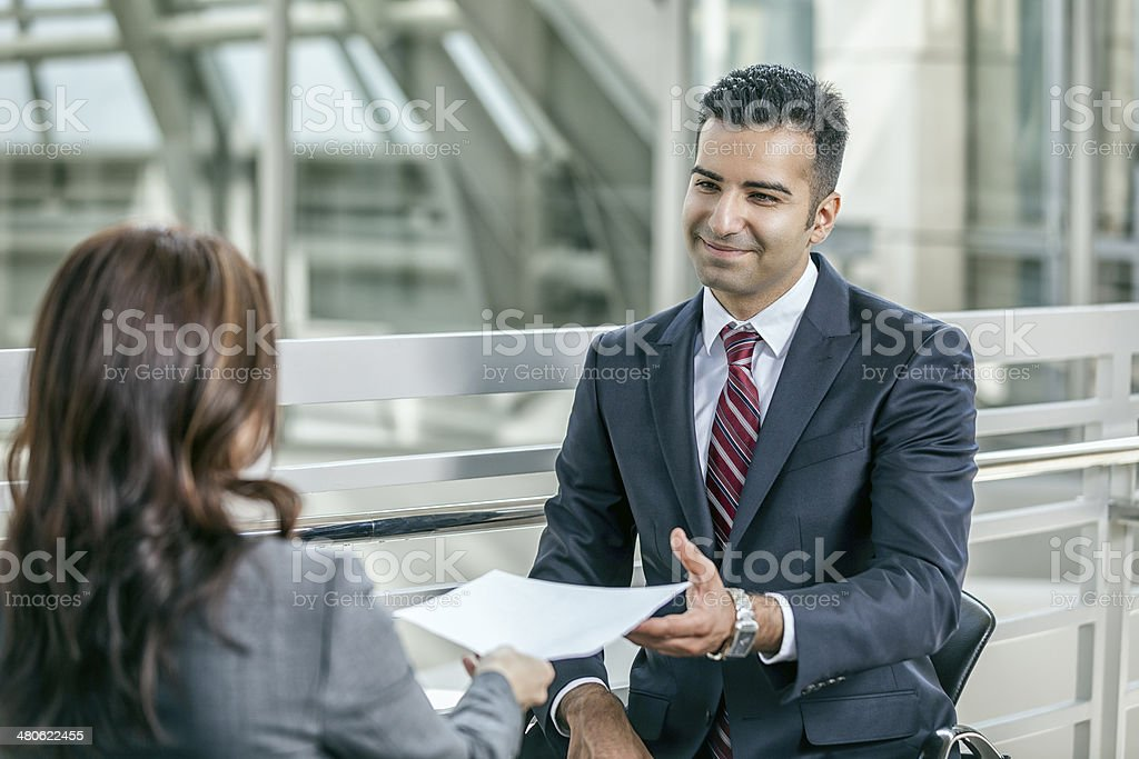 Businessman Interviewing Female Job Applicant stock photo