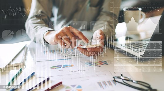 istock businessman investment consultant analyzing company financial report balance sheet statement working with digital graphs. Concept picture for stock market, cash, fund,and business economy flow. 1080548432