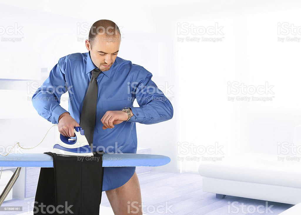 businessman ironing his trouser royalty-free stock photo