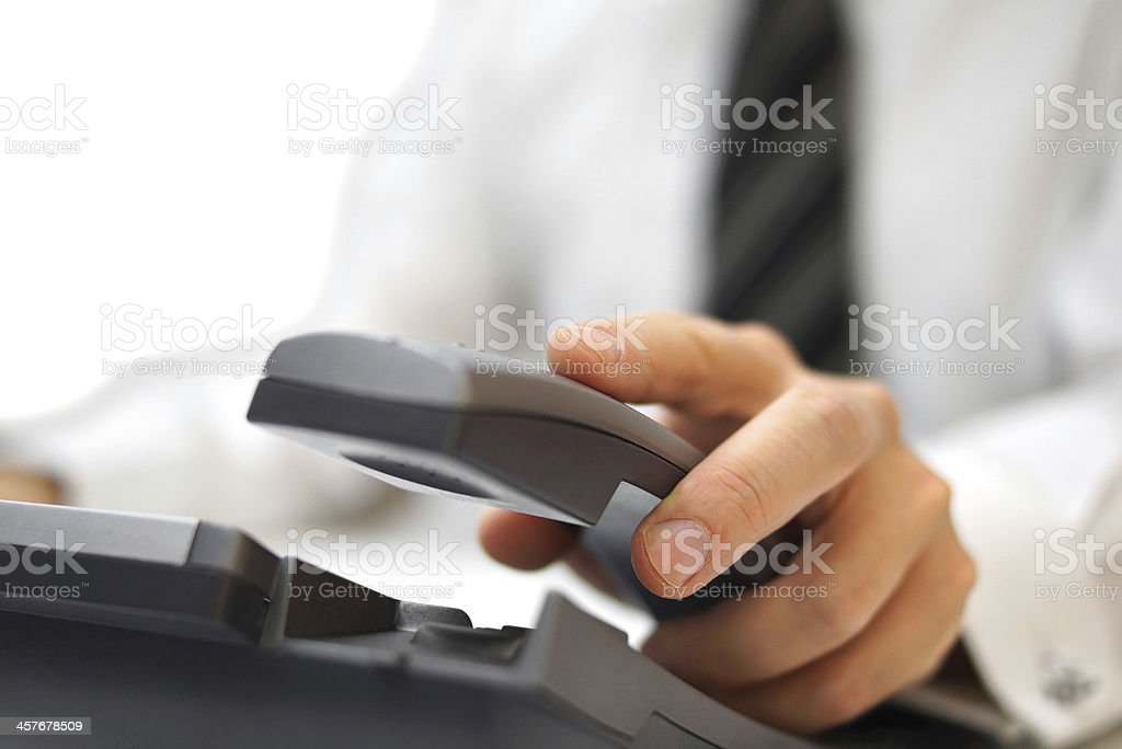 businessman is answering the phone stock photo