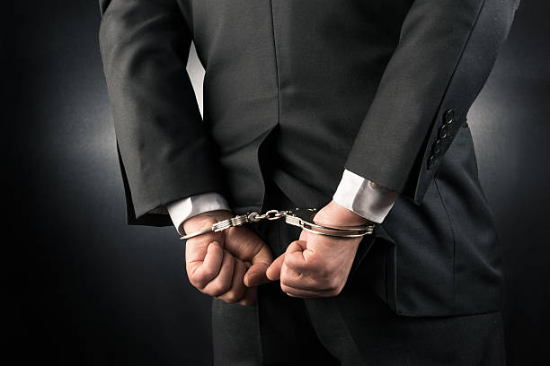 Businessman is arrested and handcuffed - foto de acervo