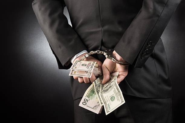 businessman is arrested and handcuffed with dollar - stealing crime stock photos and pictures