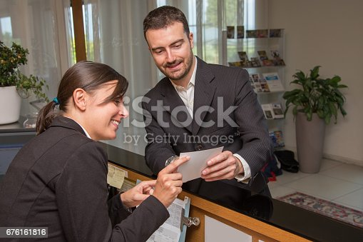 istock Businessman is arrived in hotel and is checking-in 676161816