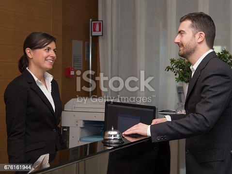 istock Businessman is arrived in hotel and is checking-in 676161944