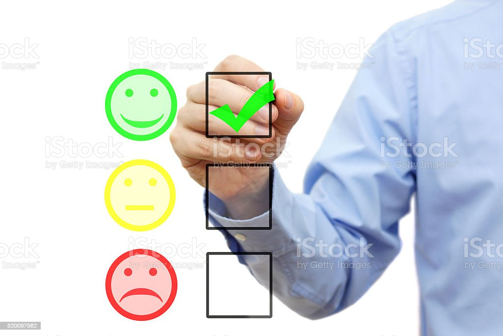 businessman is choosing smile on checklist, customer satisfaction concept stock photo