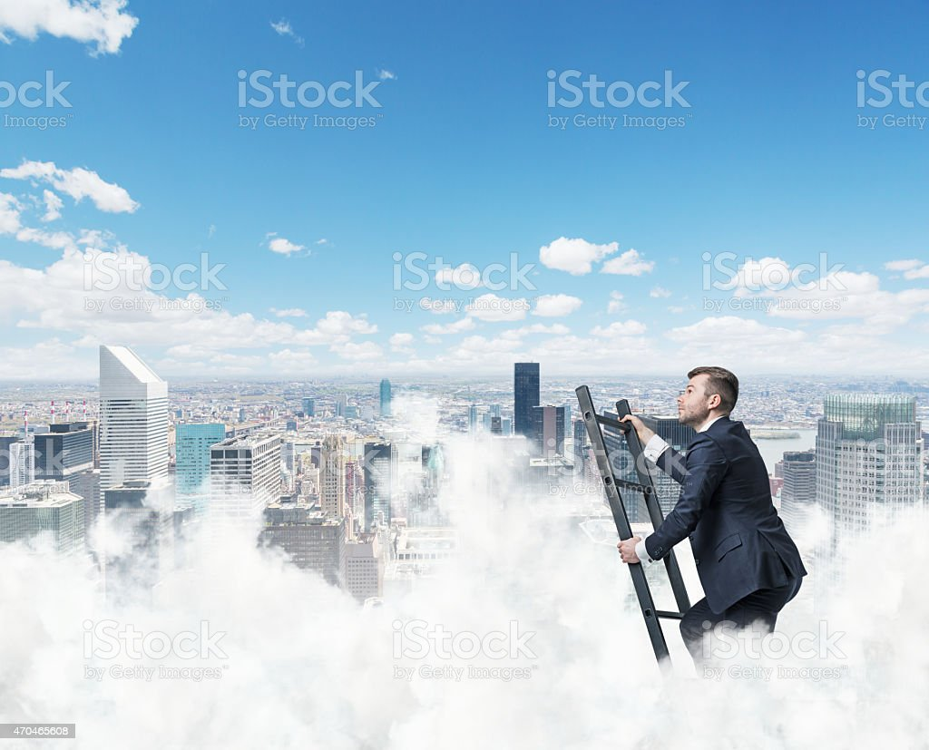 Businessman is climbing ladder to success Businessman is climbing ladder to success. New York background 2015 Stock Photo