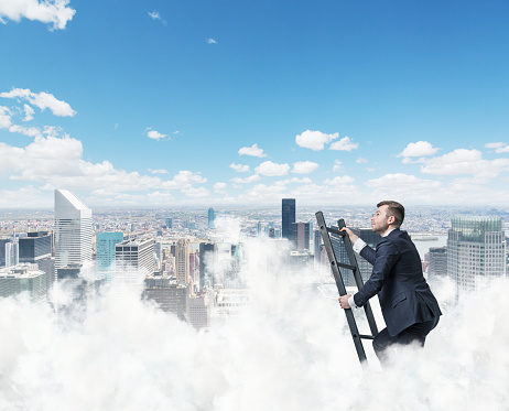 Businessman Is Climbing Ladder To Success Stock Photo - Download Image Now
