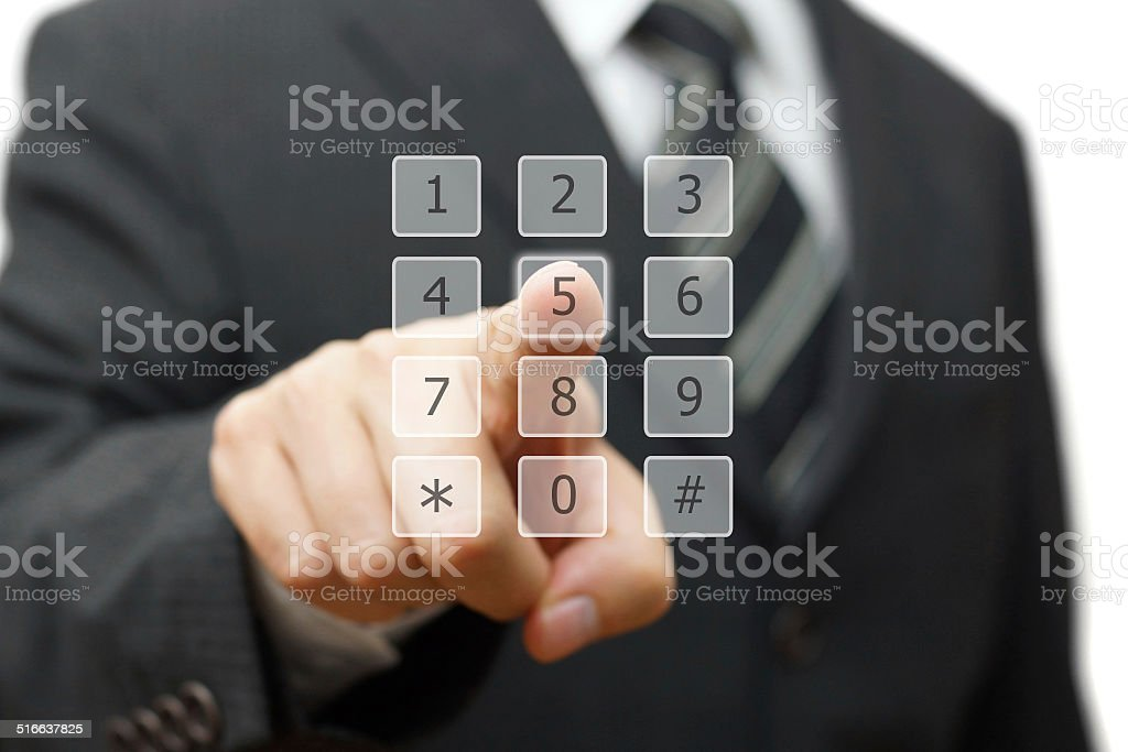 businessman is dialing on virtual telephone keypad stock photo