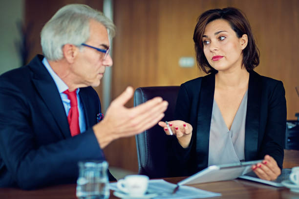 Businessman is disputing with his secretary in the office stock photo