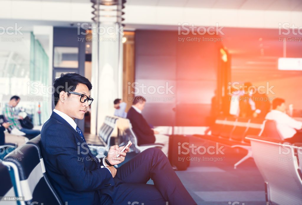 businessman is Doing Business on mobile phone, while stock photo