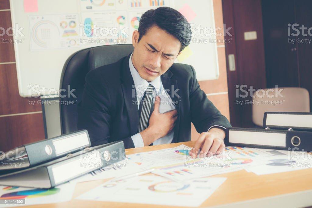 Businessman is heart disease. stock photo