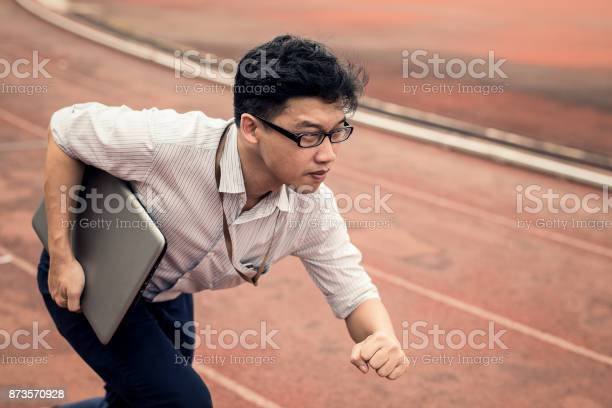 Businessman Is Holding Computer Laptop While He Is Running On Run Lane Business Man In Action Of Beginning Startup To Run Start Up Business Run To Goal Setting Concept Stock Photo - Download Image Now