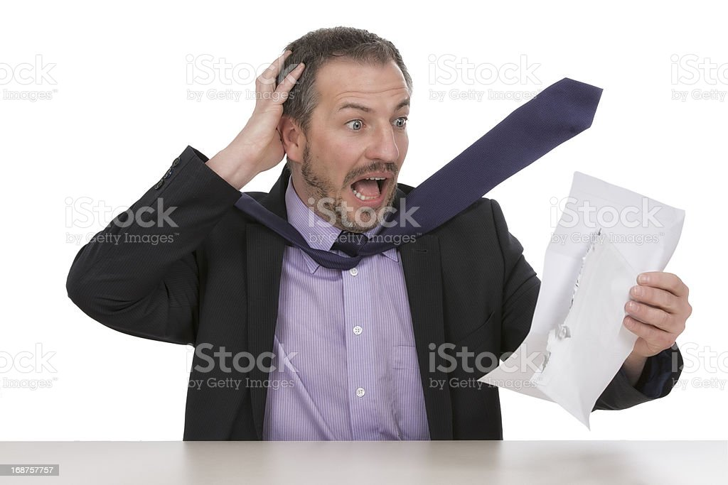 Businessman is horrified by a unbelievable bill  I royalty-free stock photo