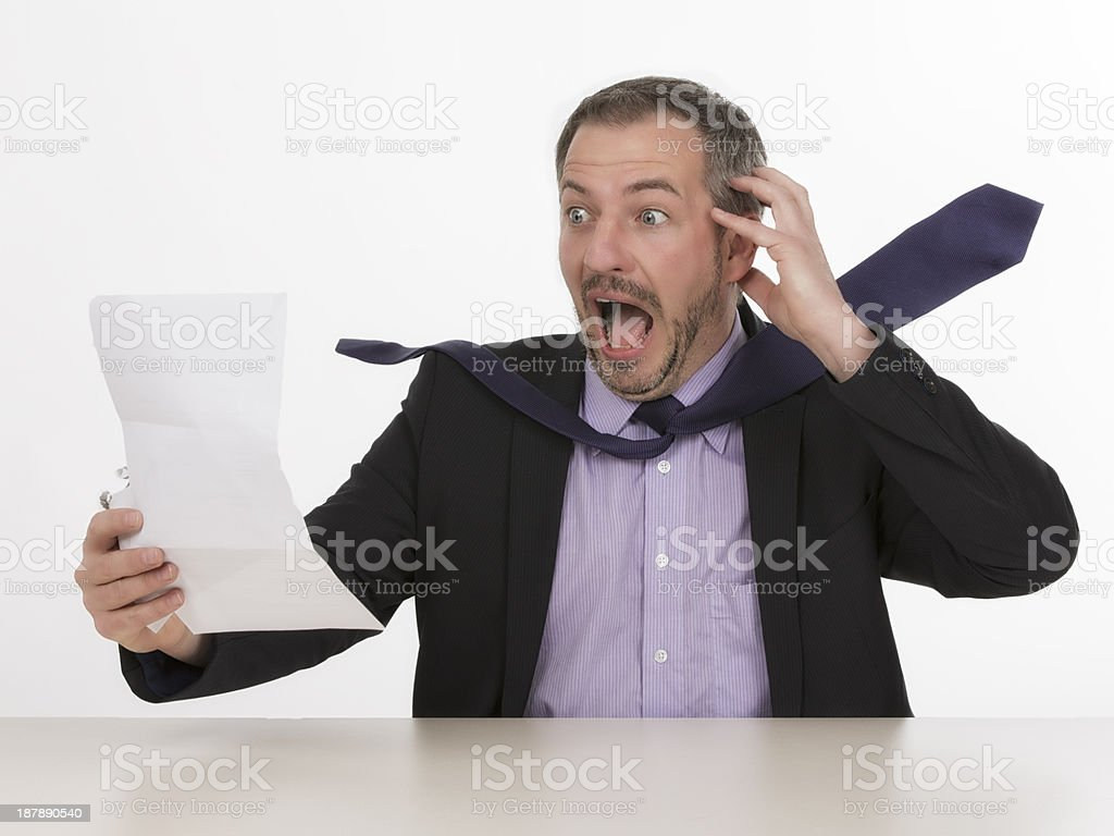 Businessman is horrified by a unbelievable bill  III royalty-free stock photo