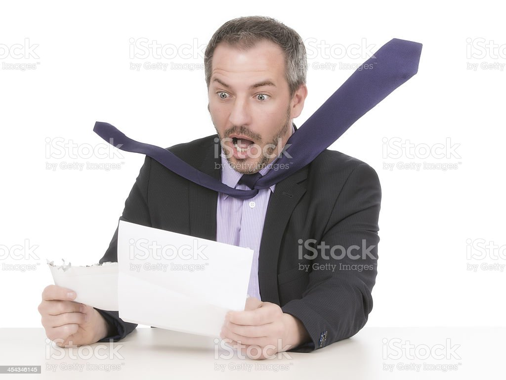 Businessman is horrified by a unbelievable bill  V royalty-free stock photo