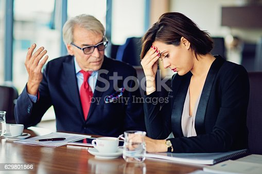istock Businessman is insulting his secretary 629801866
